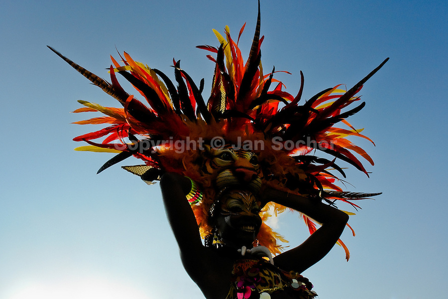 A Colombian girl, having a tiger mask, dances during the Carnival in Barranquilla, Colombia, 27 February 2006. The Carnival of Barranquilla is a unique festivity which takes place every year during February or March on the Caribbean coast of Colombia. A colourful mixture of the ancient African tribal dances and the Spanish music influence - cumbia, porro, mapale, puya, congo among others - hit for five days nearly all central streets of Barranquilla. Those traditions kept for centuries by Black African slaves have had the great impact on Colombian culture and Colombian society. In November 2003 the Carnival of Barranquilla was proclaimed as the Masterpiece of the Oral and Intangible Heritage of Humanity by UNESCO.