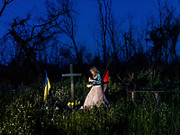 Natalia Voronkova, a volunteer who offers support and basic first aid training for Ukrainian government forces fighting Russian-backed separatists in the east of the country, visits the memorial site where one of her best friends, Andriy Galuskchenko, was killed in an ambush on 2 September, 2015.<br /> <br /> She has bought flowers and cigarettes for him, and she also light up some candles. She says the loss is still hard for her as she thinks about what might have gone through his mind the last minutes before he was killed. They were a group of four people in a car when they were first hit by a roadside bomb and then shot at with an RPG and handguns. Others survived, but he didn't. Across the landscape of eastern Ukraine, memorial sites for fallen soldiers are a common sight, some from World War II, some from this war.
