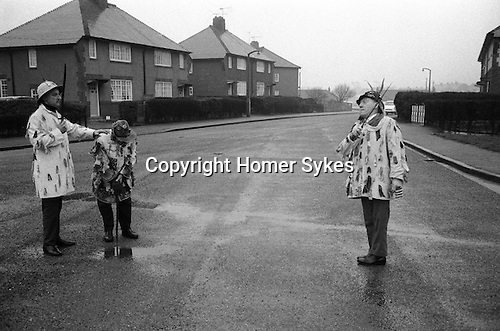 Ripon Sword Dance Play, Boxing Day, Ripon, Yorkshire 1971. Eddie Hardcastle ( on right) with family members. Performance taking place in King Edward Road, Holmefield Estate, Ripon. <br /> <br /> My ref processed in January 1972, taken Boxing Day 1971<br /> <br /> TRADITIONAL FOLKLORE ANNUAL CUSTOMS AND ANNUAL VILLAGE TRADITIONS 1970S UK