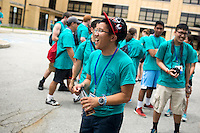 """Tuan Pham reacts to a group chant at lunch during """"Circle the City with Service,"""" the Kiwanis Circle K International's 2015 Large Scale Service Project, on Wednesday, June 24, 2015, in Indianapolis. (Photo by James Brosher)"""