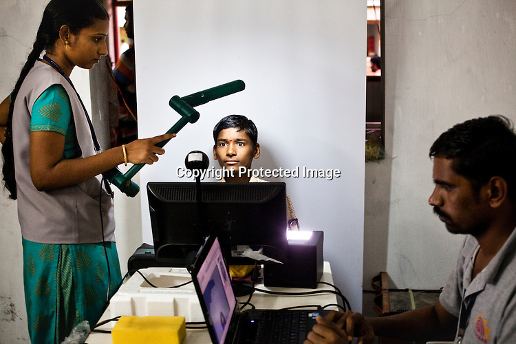 A young boy sits in front of the camera to have his picture taken as part of the enrollment that is on its way in Naagaaram village, outskirts of Hyderabad in Andhra Pradesh, India. India is assigning each one of its 1.2 billion people a unique ID number based on digital finger prints and iris scan. Photograph: Sanjit Das/Panos