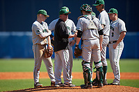 Dartmouth Big Green head coach Bob Whalen (2) talks with pitcher Zac Bygum (12) during a game against the Bradley Braves on March 21, 2019 at Chain of Lakes Stadium in Winter Haven, Florida.  Also shown (clockwise) catcher Ben Rice (9), third baseman Steffen Torgersen (29), shortstop Nate Ostmo (5), second baseman Sean Sullivan (hidden), and first baseman Michael Calamari (3).  Bradley defeated Dartmouth 6-3.  (Mike Janes/Four Seam Images)