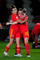 Angharad James of Wales Women's hugs Lilly Woodham of Wales Women's at full time during the UEFA Women's EURO 2022 Qualifier match between Wales Women and Faroe Islands Women at Rodney Parade in Newport, Wales, UK. Thursday 22 October 2020