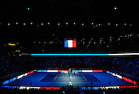 Novak Djokovic (SRB) and Kei Nishikori (JPN) stand for a minutes silence for the Paris Terror Attack on the 13th of November, as the court is lit up in the colours of the French flag, during Day One of the Barclays ATP World Tour Finals 2015 played at The O2, London on November 15th 2015