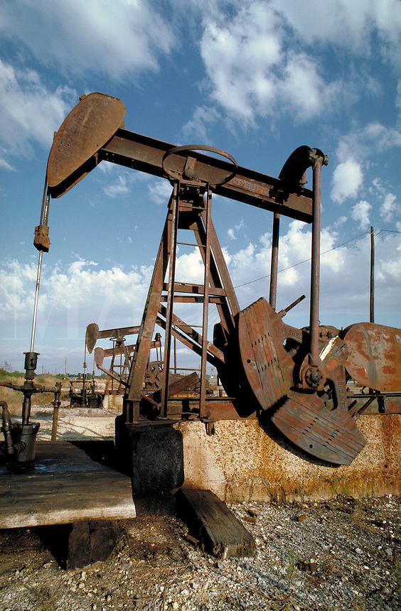 Petroleum Industry; oil; production; well; pumpjack;. Baytown Texas.