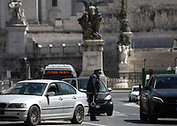 A police officer stops cars to check traveling permits in central Rome on May 4, 2020 as Italy starts to ease its lockdown, during the countrys lockdown aimed at curbing the spread of the COVID-19 infection, caused by the novel coronavirus.<br /> UPDATE IMAGES PRESS/Isabella Bonotto