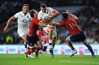 Jonny May of England is tackled by Morgan Parra and Sofiane Guitoune of France - 15/08/2015 - Twickenham Stadium - London <br /> Mandatory Credit: Rob Munro/Stewart Communications