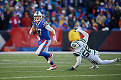 Buffalo Bills quarterback Josh Allen (17) scrambles under pressure from Kevin Pierre-Louis (56) during an NFL football game against the New York Jets, Sunday, December 9, 2018, in Orchard Park, N.Y.  (Mike Janes Photography)