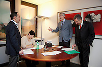 Switzerland. Canton Ticino. Lugano. Société Générale Private Banking. (Left to right) Luigi Di Pirro, Lorenza Lurà, Marco Tini (Executive General Director) and Renzo Triulzi. The three men stand up during their meeting while the assistant seats and takes notes. 5.03.12 © 2012 Didier Ruef