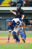 Burlington Royals catcher Pedro Gonzalez (13) checks the runner on third base as he picks up a wild pitch during the Appalachian League game against the Elizabethton Twins at Burlington Athletic Park on August 11, 2013 in Burlington, North Carolina.  The Twins defeated the Royals 12-5.  (Brian Westerholt/Four Seam Images)