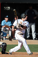 Adam Barry #22 of the Cal State Northridge Matadors bats against the Rhode Island Rams at Matador Field on March 14, 2012 in Northridge,California. Rhode Island defeated Cal State Northridge 10-8.(Larry Goren/Four Seam Images)