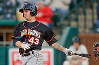 Justin Dalles #43 of the Delmarva Shorebirds follows through on his swing against the Greensboro Grasshoppers at NewBridge Bank Park April 15, 2010, in Greensboro, North Carolina.  Photo by Brian Westerholt / Four Seam Images