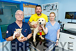 Maurice Enright of Sera Husky Animal rescue with Goldie the dog at Treacy and Sheehan Animal Health Care in Listowel on Saturday morning.<br /> Sean Treacy, Maurice Enright with Goldie the dog, Olivia Dennihan and Clive the cat.