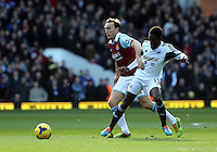 Pictured: Nathan Dyer of Swansea (R) challenged by a West Ham player. 01 February 2014<br /> Re: Barclay's Premier League, West Ham United v Swansea City FC at Boleyn Ground, London.