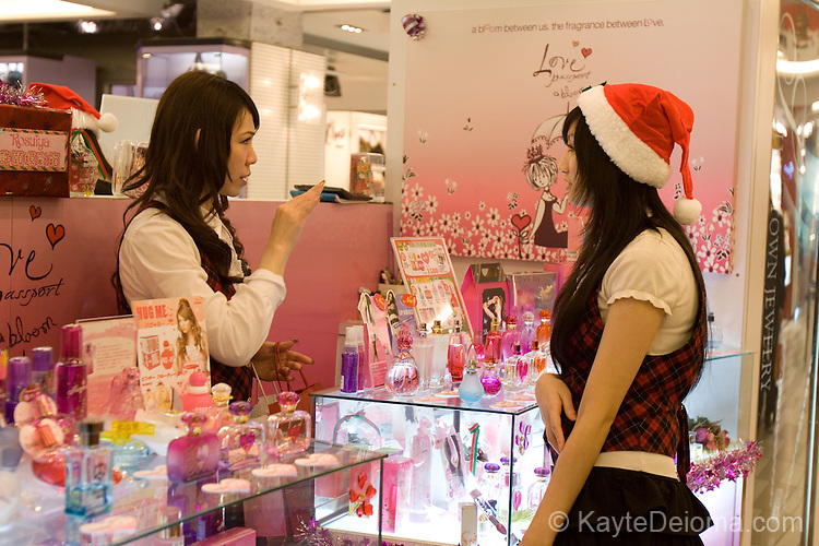 Shop clerks wait for customers at Christmas in a shop in Shimen District, Taipei, Taiwan