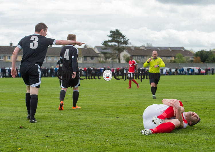 Eoin Hayes of Newmarket Celtic roars in pain after being taken down by Shane Clarke of Janesboro during their Munster Junior Cup semi-final at Limerick. Photograph by John Kelly.