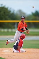 GCL Astros second baseman Juan Pineda (16) throws to first as Aldrem Corredor (5) slides in during a game against the GCL Nationals on August 14, 2016 at the Carl Barger Baseball Complex in Viera, Florida.  GCL Nationals defeated GCL Astros 8-6.  (Mike Janes/Four Seam Images)