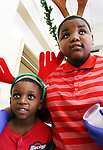 WATERBURY CT. 25 December 2018-122518SV02-From left, Jamel Copper, 7, and his brother Dante Copper, 9, help to serve dinner while volunteering at the annual free Joy of Christmas Dinner at the First Congregational Church in Waterbury Tuesday.<br /> Steven Valenti Republican-American