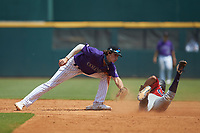 Shortstop Izaac Pacheco (23) of Friendswood HS in Friendswood, TX playing for the Colorado Rockies scout team applies a tag to Aries Samek (39) of Teaneck HS in Teaneck, NJ playing for the Boston Red Sox scout team during the East Coast Pro Showcase at the Hoover Met Complex on August 4, 2020 in Hoover, AL. (Brian Westerholt/Four Seam Images)