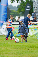Pictured: Children playing football Monday 20 July 2015<br />
