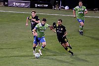 COLUMBUS, OH - DECEMBER 12: Will Bruin #17 of the Seattle Sounders FC holds off a challenge by Artur #8 of the Columbus Crew during a game between Seattle Sounders FC and Columbus Crew at MAPFRE Stadium on December 12, 2020 in Columbus, Ohio.