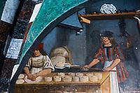 Italie, Val d'Aoste,  Issogne: Château d'Issogne,  fresques des lunules des arcades, réalisées par le maître Colin. représentant des scènes de vie quotidienne: le boulanger // Italy, Aosta Valley,  Issogne: Issogne Castle: The lunettes of the portico are decorated with frescoes giving realistic and humorous depictions of scenes daily life and the trades of the period, the baker