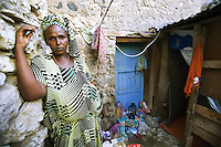 """Djibouti. Djibouti province. Djibouti town. Quartier 2. Shadia is a muslim commercial sex worker (CSW). She stands outside her small room where she prostitutes herself for 300 Djibouti Francs ( around 1.5 US$). She always use condoms with her customers. Sabah is one of the prostitutes belonging to the association Al-Salaam, which means """"Soeur à Soeur"""" (Sister to sister). The Global Fund through the djiboutian Ministry of Health supports the condoms distribution with an Aids grant (financial aid).  © 2006 Didier Ruef"""