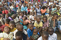 Kenya. Rift Valley province. Nakuru. 23.01.2008. A group of black Kikuyu children, seated on the floor, wait for the food distribution at Show Ground. All kids are Internally displaced persons (IDPs) forced to flee their homes because of the inter-ethnic strife, but who, unlike refugees, remain within their country's borders. The Kikuyus are Kenya's most populous ethnic group.  © 2008 Didier Ruef