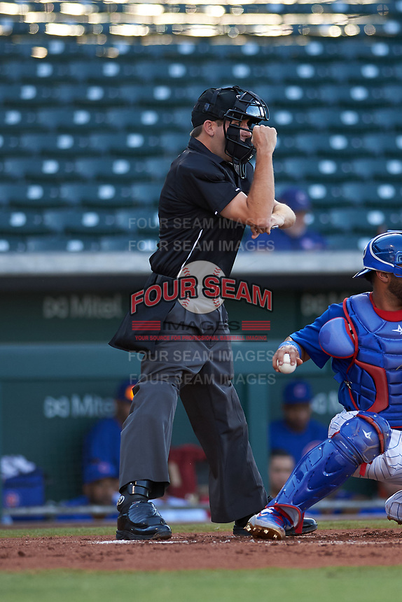 Home plate umpire Cas Cousins calls a strike on a batter during an Arizona League game between the AZL Cubs 1 and the AZL Athletics Gold at Sloan Park on June 20, 2019 in Mesa, Arizona. AZL Athletics Gold defeated AZL Cubs 1 21-3. (Zachary Lucy/Four Seam Images)