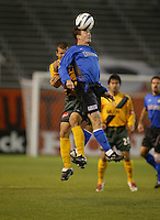 Richard Mulrooney (Earthquakes) and Arturo Torres (Galaxy). Earthquakes defeated Galaxy, 5-2 in overtime at Spartan Stadium on November 9th, 2003.