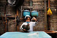 "Djarida, dressed up as a veterinarian, holds a chicken and pretends to inject it with a syringe..Djarida is 8 years old and lives in San Cristobal de las Casas in Chiapas, Mexico. She is from a Mayan family background. Mayans are one of the indigenous peoples of Mexico, many of whom today are poor and disadvantaged. Djarida's father left the family home and her mother works as a housekeeper in the city. Djarida loves all animals, especially dogs. ""Many girls are not allowed to go to school or only for a short time. Then they are required to help at home, to get married or to work. I'm happy going to school every day. When I grow up I want to be a veterinarian. I have to study hard but I'm sure I will succeed."" .."