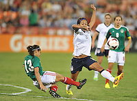 Sydney Leroux (2) of the USWNT goes against Arianne Romero (13) of Mexico. The USWNT defeated Mexico 7-0 during an international friendly, at RFK Stadium, Tuesday September 3, 2013.