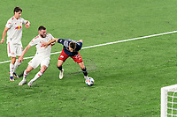 FOXBOROUGH, MA - MAY 22: Arnor Traustason #25 of New England Revolution attempts to control the ball in the box as Thomas Edwards #7 of New York Red Bulls closes during a game between New York Red Bulls and New England Revolution at Gillette Stadium on May 22, 2021 in Foxborough, Massachusetts.