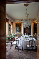 Two tables laid ready for a meal in one of the Grand Dining room designed by Francis Smith