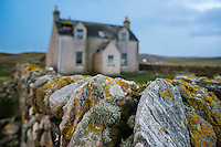 Stone wall around derelict abandoned house, Berneray, Outer Hebrides, Scotland