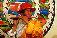 A Tibetan flute player performs during a Yak-Dance in Tashi II, the restaurant and internet cafe of the Kirey Hotel, Lhasa, Tibet.