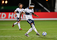 LAKE BUENA VISTA, FL - JULY 26: Derek Cornelius of Vancouver Whitecaps FC passes the ball during a game between Vancouver Whitecaps and Sporting Kansas City at ESPN Wide World of Sports on July 26, 2020 in Lake Buena Vista, Florida.