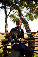 15 year old Gweni Mwanabene from Kafinda basic school in Sereje district, on her first safari in Kasanka National Park. Local schools and women's groups are regularly brought into Kasanka, which is unique in the country and unusual in Africa as it is privately managed and owned by a trust. People are able to see animals flourishing in land which was once free reign for poachers. Combined with anti-poaching scouts, the education programme is on the frontline of conservation methods in the park, showing local people wild animals in their natural habitat.