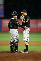 Bristol Pirates relief pitcher Alec Rennard (19) talks with Gabriel Brito (52) on the mound during a game against the Bluefield Blue Jays on July 26, 2018 at Bowen Field in Bluefield, Virginia.  Bristol defeated Bluefield 7-6.  (Mike Janes/Four Seam Images)