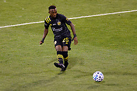 COLUMBUS, OH - DECEMBER 12: Harrison Afful #25 of Columbus Crew kicks the ball against Seattle Sounders FC during a game between Seattle Sounders FC and Columbus Crew at MAPFRE Stadium on December 12, 2020 in Columbus, Ohio.