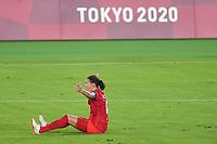 YOKOHAMA, JAPAN - AUGUST 6: Christine Sinclair #12 of Canada looks for a call during a game between Canada and Sweden at International Stadium Yokohama on August 6, 2021 in Yokohama, Japan.