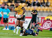 30th April 2021; Wellington, New Zealand;  Hurricanes Ngani Laumape slips a tackle.  Hurricanes versus  Highlanders, Super Rugby, Sky Stadium, Wellington New Zealand, Friday 30 April 2021.