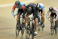 New Zealand's Eddie Dawkins, right, and Australia's Shane Perkins race to the finish line in the mens keirin final at the UCI Tier 1 Festival of Speed, SIT Zero Fees Velodrome, Invercargill, New Zealand, Saturday, November 16, 2013. Credit:NINZ/Dianne Manson