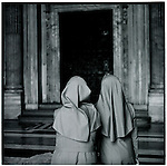 Two nuns admire a door at the vatican in Rome, ItalyEurope before the euro.