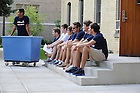 August 17, 2012; Members of the St. Edward's Hall orientation staff take a break while waiting for the next wave of cars to unload during move in day.  Photo by Barbara Johnston/University of Notre Dame