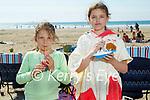 Enjoying their ice creams on Banna beach on Sunday, l to r: Isabelle Cahill and Basha Witkowska.