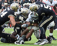 Purdue's defense led by Mike Neal (92) and Brandon King (7) sacks the Ohio State quarterback Terrelle Pryor. The Purdue Boilermakers defeated the Ohio State Buckeyes 26-18 at Ross-Ade Stadium, West Lafayette, Indiana on October 17, 2009..