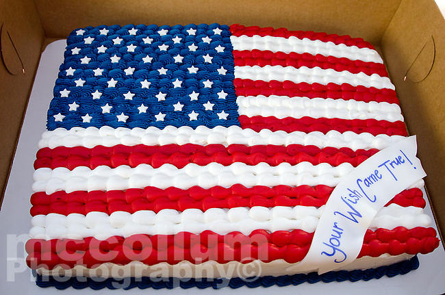 """Michael McCollum<br /> 8/2/18<br /> Special Cake donated by Everything Iced Bakery in Knoxville at the reveal ceremony where it was announced to 13 year old Ryan Overman of west Knoxville that The Wish Connection is granting Ryan's wish to go to Washington DC and visit the White House at Carl Cowan Park, 10058 S Northshore Dr, Knoxville, TN, Thursday, August 2, 2018 at 5:45pm. Approximately 50-60 people attended, including the Overman family, friends, and AT&T Employees. The Bearden High School Cadets also attended and lead the pledge of allegiance.<br /> The AT&T Wish Connection is going to send Ryan, his family, and his service dog to Washington DC and while they are gone, the group of volunteers will be doing a makeover on his bedroom and turn it into the """"Oval Office"""" at the White House.<br /> Ryan was born two weeks prematurely on May 13, 2005. During the pregnancy he was classified as high risk due to a measured lack of growth and, after a brief stay in the hospital, he came home weighing only 4 lbs 5 oz. His development was much slower compared to his peers, such as not learning to walk until he was well over a year old, and he was much smaller. The Overman family worked with Tennessee Early Intervention Services (TEIS) when Ryan was about one year old and with their help they were able to get Ryan enrolled through TEIS to receive Occupational, Physical, and Speech Therapy. When Ryan turned three he transitioned from TEIS to the Knox County Early Intervention Program and began attending a special school to continue his therapies until he was old enough to enroll at Cedar Bluff Elementary and now is at Cedar Bluff Middle School. In 2016, Ryan was diagnosed to have retinitis pigmentosa, a degenerative disease of the retinas that under the best of circumstances causes severe tunnel vision, but more commonly results in complete blindness.<br /> Despite the physical difficulties that Ryan has had to endure over the last thirteen years, he continually brightens the"""