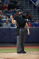 Home plate umpire Tyler White makes a strike call during the game between the Wilmington Blue Rocks and the Hudson Valley Renegades at Dutchess Stadium on July 27, 2021 in Wappingers Falls, New York. (Brian Westerholt/Four Seam Images)
