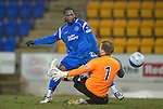 St Johnstone v Partick Thistle....09.02.11  Scottish Cup 5th Round.Collin Samuel clips the ball overt Scott Fox only to see his shot hit the upright.Picture by Graeme Hart..Copyright Perthshire Picture Agency.Tel: 01738 623350  Mobile: 07990 594431
